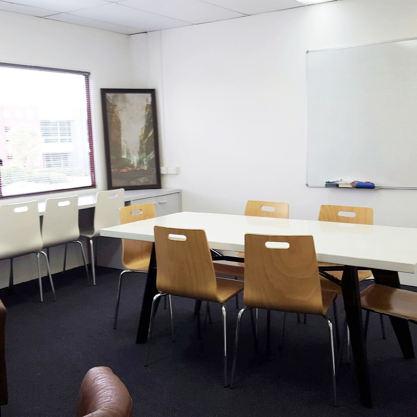 Our larger meeting room, The Boardroom, has been extensively used for seminars and group meetings. Located on the upper level, it is popular with our Clients who provide training, counselling services and also for interview purposes. Clients are greeted by our Reception staff on arrival where refreshments can be made to order and access to our pay-as-you-use business machines is also conveniently located. The Boardroom has a lovely street aspect and can seat up to 10 people comfortably as well as providing a conversation nook for more intimate meetings. It is also fully air-conditioned and has a high speed, cable or Wi-Fi internet connection included in the hire charges. With whiteboard facilities, it is perfect for demonstrations and presentations. It can be configured in many ways and our Reception staff are happy to assist with set up requirements.